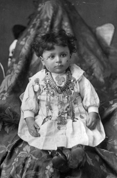 John Attey, son of John and Sarah Attey, wearing his godmother's dowry necklace, circa 1900. His parents were both Lebanese immigrants who married when John was 18 and Sarah was 15. Photo Courtesy Utah State Historical Society