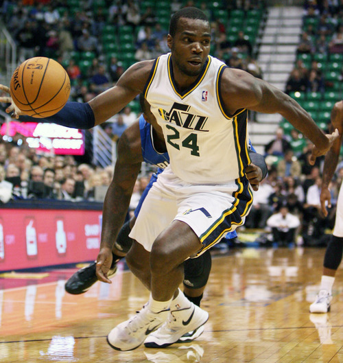 Kim Raff  |  The Salt Lake Tribune Utah Jazz power forward Paul Millsap (24) drives the basket during a game against Orlando at EnergySolutions Arena in Salt Lake City on December 5, 2012.