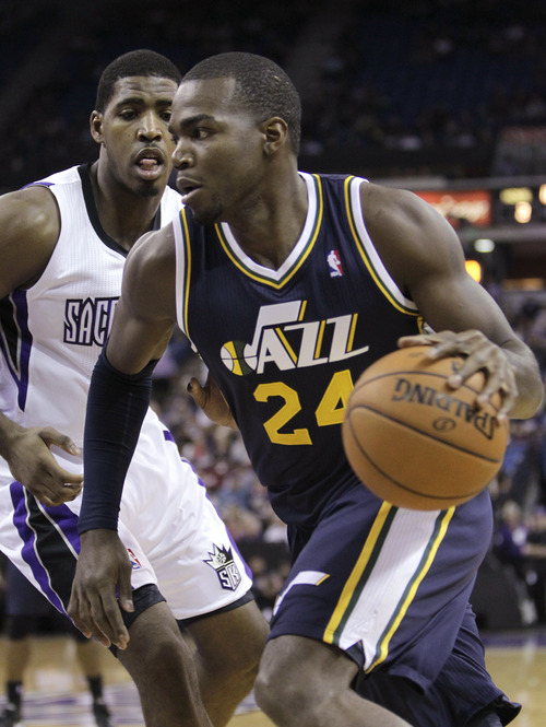 Utah Jazz forward Paul Millsap, right, drives to the basket against Sacramento Kings forward Jason Thompson during the first half of an NBA basketball game in Sacramento, Calif., Saturday, Nov. 24, 2012. (AP Photo/Rich Pedroncelli)