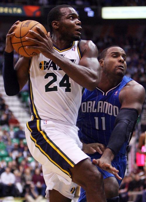 Kim Raff  |  The Salt Lake Tribune Utah Jazz power forward Paul Millsap (24) drives the basket as Orlando Magic power forward Glen Davis (11) defends during a game at EnergySolutions Arena in Salt Lake City on December 5, 2012.
