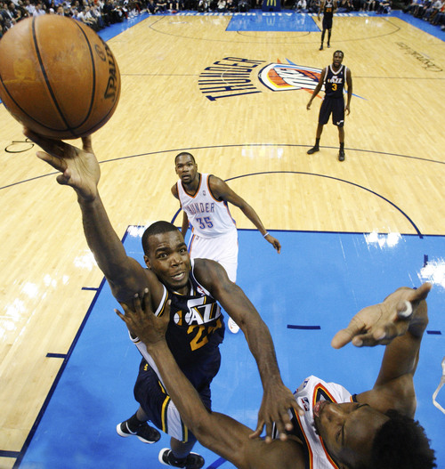 Utah Jazz forward Paul Millsap (24) shoots over Oklahoma City Thunder center Hasheem Thabeet, right, in the third quarter of an NBA basketball game in Oklahoma City, Friday, Nov. 30, 2012. Oklahoma City won 106-94. (AP Photo/Sue Ogrocki)