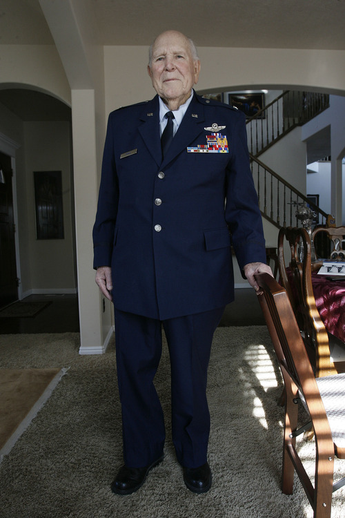 "Scott Sommerdorf  |  The Salt Lake Tribune               Emmett ""Cyclone"" Davis poses in his Air Force uniform in his home in Highland, Thursday, December 6, 2012. Davis, a native of Roosevelt, was a young pilot in the Army Air Corps, based at Wheeler Field in Hawaii, when the Japanese attacked Pearl Harbor on Dec. 7, 1941. He was one of the few pilots able to get into the air in an attempt to defend Pearl Harbor. He is now 93 (94 this month) and lives in his own home with his wife, Majorie. His son, Tucker, is writing a biography of his father."