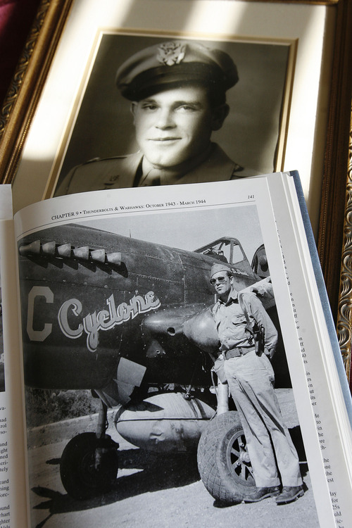 "Scott Sommerdorf  |  The Salt Lake Tribune               Emmett ""Cyclone"" Davis, a native of Roosevelt, was a young pilot in the Army Air Corps, based at Wheeler Field in Hawaii, when the Japanese attacked Pearl Harbor on Dec. 7, 1941. He is shown in a portrait from his early years, and standing next to his P-40 fighter during WW II."