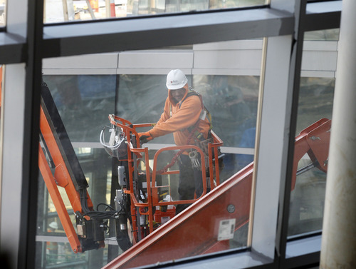 Al Hartmann     The Salt Lake Tribune A worker on a high lift works on the north side exterior windows of the new Salt Lake City Public Safety Building at the corner of 300 East and 500 South on Thursday, Dec. 6, 2012.