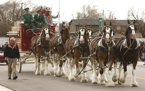 Leah Hogsten  |  The Salt Lake Tribune The Budweiser Clydesdale team visits veterans and their families at the George E. Wahlen Veterans Home on Friday in Ogden. The Utah Department of Veterans Affairs held a Pearl Harbor remembrance ceremony at the home.