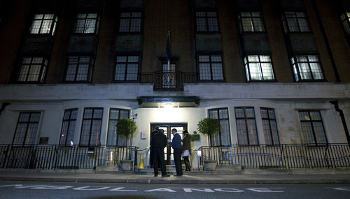 FILE - In this Monday, Dec. 3, 2012 file photo, policeman stand guard outside the King Edward VII hospital where the Duchess of Cambridge has been admitted with a severe form of morning sickness,  in London. King Edward VII hospital says the nurse involved in Kate hoax call has died, it has been announced, Friday, Dec. 7, 2012. (AP Photo/Alastair Grant, File)