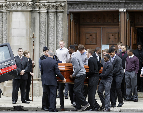 The casket of former college basketball coach Rick Majerus is carried by players from the Saint Louis University basketball team during a funeral service at the Church of the Gesu on Saturday, Dec. 8, 2012, in Milwaukee. Milwaukee-born Majerus died Dec. 1 of heart failure at the age of 64 at a Los Angeles hospital. He served as head coach at Marquette, Ball State, Utah and, after a few years working as an ESPN commentator, Saint Louis for the past five seasons. (AP Photo/Milwaukee Journal-Sentinel, Angela Peterson)