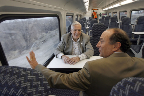 "Francisco Kjolseth  |  The Salt Lake Tribune UTA board member and vice chairman H. David Burton, left, and UTA General Manager Michael Allegra admire the work done as they ride the new FrontRunner line from Salt Lake City to Provo on Friday as UTA gets ready to open for regular service on Monday. The public is also welcome to try out the line as part of their ""Food for your fare"" on Saturday from 10 a.m to 10 p.m by providing a non-perishable food item to be donated as ""fare"" to benefit the Utah Food Bank and the Community Action Services."