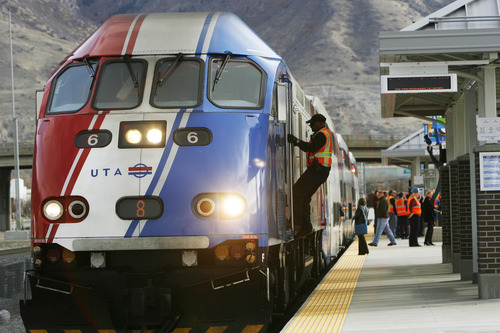 "Francisco Kjolseth  |  The Salt Lake Tribune Train operator Ananda Alles climbs aboard the FrontRunner engine as he gets ready to transport the media from the new Provo station back to Salt Lake City on Friday, November 30, 2012, as UTA gets ready to open for regular service on Monday, December 10, 2012. The public is also welcome to try out the line as part of their ""Food for your fare"" on Saturday, December 8, 2012, from 10 a.m to 10 p.m by providing a non-perishable food item to be donated as ""fare"" to benefit the Utah Food Bank and the Community Action Services."
