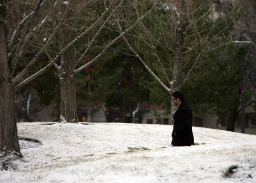 Kim Raff     The Salt Lake Tribune A man walks through Library Square as snow falls in Salt Lake City on December 8, 2012.