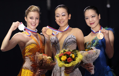 From left, Ashley Wagner, of the United States, Asada Mao, and Suzuki Akiko, both of Japan, show off their silver, gold and bronze medals during awarding ceremony at the ISU Figure Skating Grand Prix Final event, at Iceberg stadium in Sochi, Russia, on Saturday, Dec. 8, 2012. (AP Photo/Ivan Sekretarev)