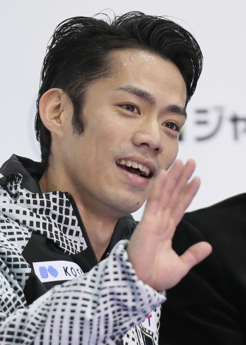 Takahashi Daisuke, of Japan, center, reacts after skating his free program to win the gold at the ISU figure skating Grand Prix Final event, at Iceberg stadium in Sochi, Russia, on Saturday, Dec. 8, 2012. (AP Photo/Ivan Sekretarev)
