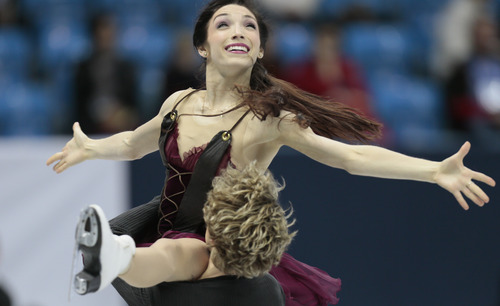 Meryl Davis and Charlie White, of the United States, skate their free dance to win the gold at the ISU figure skating Grand Prix Final event, at Iceberg stadium in Sochi, Russia, on Saturday, Dec. 8, 2012. (AP Photo/Ivan Sekretarev)