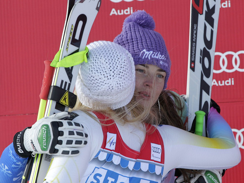 Second placed Tina Maze of Slovenia, right, embraces first placed Lindsey Vonn of the United States on the podium, after the women's World Cup super G  race in St. Moritz, Switzerland, Saturay, Dec. 8, 2012. (AP Photo/Keystone, Arno Balzarini)