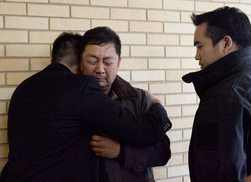 Kim Raff  |  The Salt Lake Tribune Don Phan, left, brother of 14-year-old David Phan, comforts his father, Nhuan Phan, on Sunday during the family's first public comments on David's suicide. The family said through a spokesman that David had shielded them from the horror he was experiencing, including from bullying.