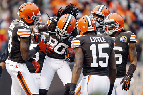 Cleveland Browns wide receiver Travis Benjamin (80) is congratulated by teammates after a 93-yard punt return for a touchdown in the second quarter of an NFL football game against the Kansas City Chiefs in Cleveland, Sunday, Dec. 9, 2012. (AP Photo/Rick Osentoski)