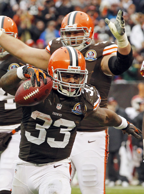 Cleveland Browns running back Trent Richardson (33) celebrates after a 1-yard touchdown run against the Kansas City Chiefs in the third quarter of an NFL football game Sunday, Dec. 9, 2012, in Cleveland. (AP Photo/Tony Dejak)