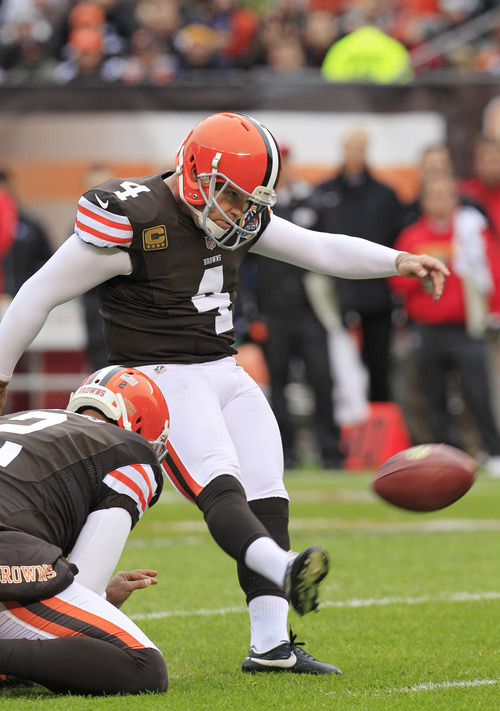 Cleveland Browns place kicker Phil Dawson (4) kicks a 23-yard field goal against the Kansas City Chiefs in the first quarter of an NFL football game Sunday, Dec. 9, 2012, in Cleveland. The field goal was the 300th of Dawson's NFL career. (AP Photo/Tony Dejak)
