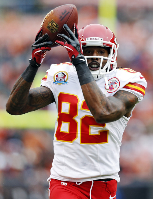 Kansas City Chiefs wide receiver Dwayne Bowe makes a catch for a first down in the first quarter of an NFL football game against the Cleveland Browns in Cleveland, Sunday, Dec. 9, 2012. (AP Photo/Rick Osentoski)