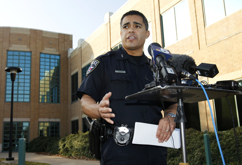 Irving Police Department Public Information Officer John Argumaniz responds to questions outside their department headquarters during a news conference regarding the auto accident involving Dallas Cowboys player Josh Brent Saturday, Dec. 8, 2012, in Irving, Texas. Brent is facing an intoxication manslaughter charge after a one-vehicle accident that killed linebacker Jerry Brown, a member of the team's practice squad. (AP Photo/Tony Gutierrez)