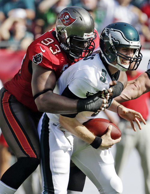 Tampa Bay Buccaneers defensive tackle Gerald McCoy (93) sacks Philadelphia Eagles quarterback Nick Foles (9) during the first quarter of an NFL football game, Sunday, Dec. 9, 2012, in Tampa, Fla. (AP Photo/Chris O'Meara)