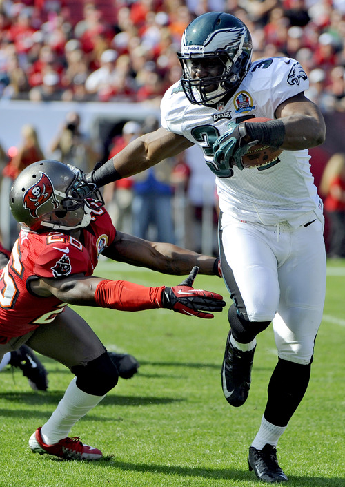 Philadelphia Eagles running back Bryce Brown (34) fends off Tampa Bay Buccaneers defensive back Anthony Gaitor (26) during the first quarter of an NFL football game, Sunday, Dec. 9, 2012, in Tampa, Fla. (AP Photo/Brian Blanco)