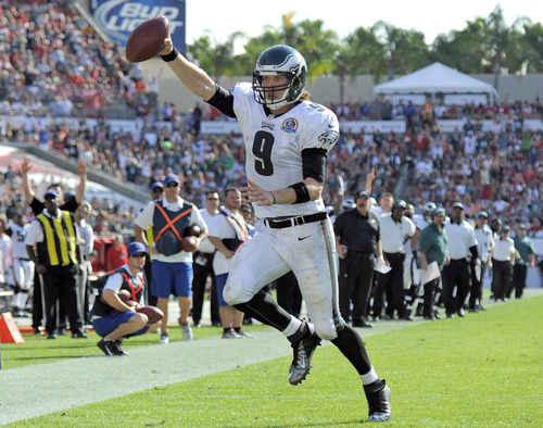 Philadelphia Eagles quarterback Nick Foles (9) runs 10-yards for a touchdown against the Tampa Bay Buccaneers during the second quarter of an NFL football game Sunday, Dec. 9, 2012, in Tampa, Fla. (AP Photo/Brian Blanco)