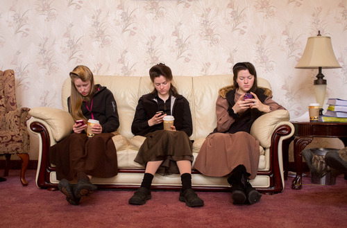 Trent Nelson  |  The Salt Lake Tribune Allie Steed, Helen Holm and Heidi Holm look at their phones Saturday, Dec. 1, 2012 in Colorado City. The three young women recently left the FLDS church.