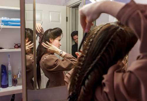 Trent Nelson  |  The Salt Lake Tribune Heidi Holm does her hair  in Colorado City. Holm and her sister Helen (at rear) recently left the FLDS church.