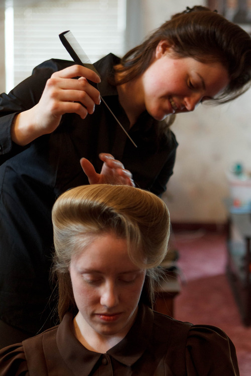 Trent Nelson  |  The Salt Lake Tribune Helen Holm works on Allie Steed's hair. The two young women recently left the FLDS church.