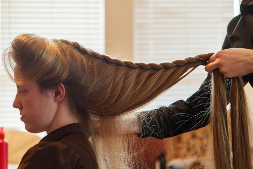 Trent Nelson  |  The Salt Lake Tribune Helen Holm works on Allie Steed's hair recently in Colorado City. The two young women recently left the FLDS church.