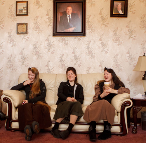 Trent Nelson  |  The Salt Lake Tribune Allie Steed, left, and twin sisters Helen Holm and Heidi Holm on Saturday Dec. 1, 2012, at the Holm home in Colorado City, Ariz. The three young women recently left the FLDS church. A portrait of the Holm's father, Lorin Holm, hangs above them.