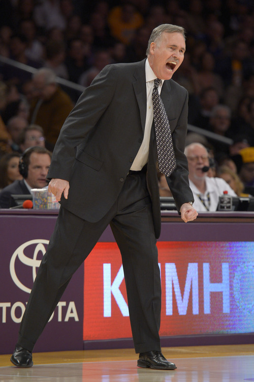 Los Angeles Lakers coach Mike D'Antoni yells to his team during the first half of their NBA basketball game against the Utah Jazz, Sunday, Dec. 9, 2012, in Los Angeles. (AP Photo/Mark J. Terrill)