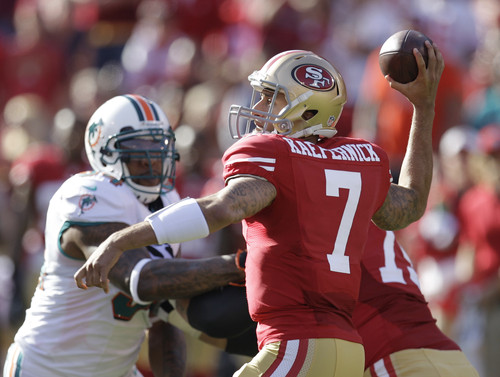 San Francisco 49ers quarterback Colin Kaepernick drops back to pass during the first quarter of an NFL football game against the Miami Dolphins in San Francisco, Sunday, Dec. 9, 2012. (AP Photo/Ben Margot)