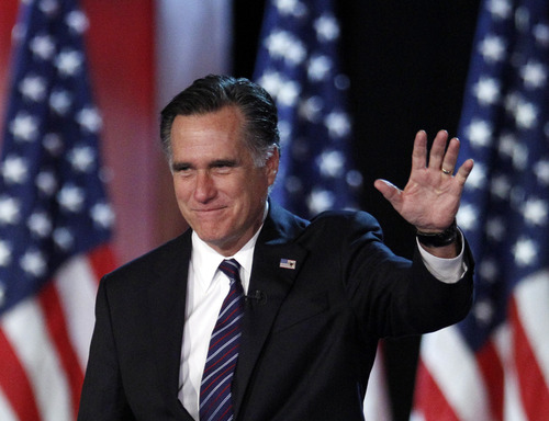 FILE - This Nov. 7, 2012 file photo shows Republican presidential candidate, former Massachusetts Gov. Mitt Romney waving to supporters at an election night rally in Boston. Romney's shadow looms over a GOP in disarray. Republican officials in Washington and elsewhere concede that Romney's immediate withdrawal from politics, while welcome by most, has created a leadership void, leaving the GOP rudderless and fighting with itself during what may be the most important policy debate in a generation.  (AP Photo/Stephan Savoia, File)