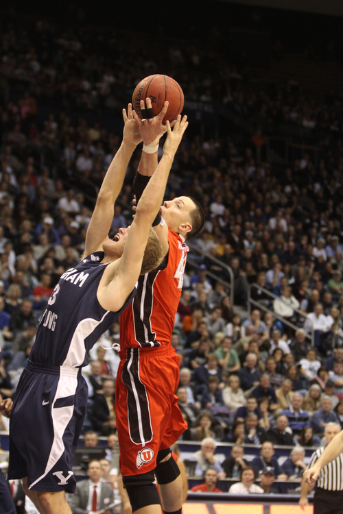 Rick Egan  | The Salt Lake Tribune   Brigham Young Cougars guard Tyler Haws (3) goes for a rebound along with Utah Utes center Jason Washburn (42) in basketball action between the Brigham Young Cougars and the Utah Utes at the Marriott Center in Provo, Saturday, December 8, 2012.