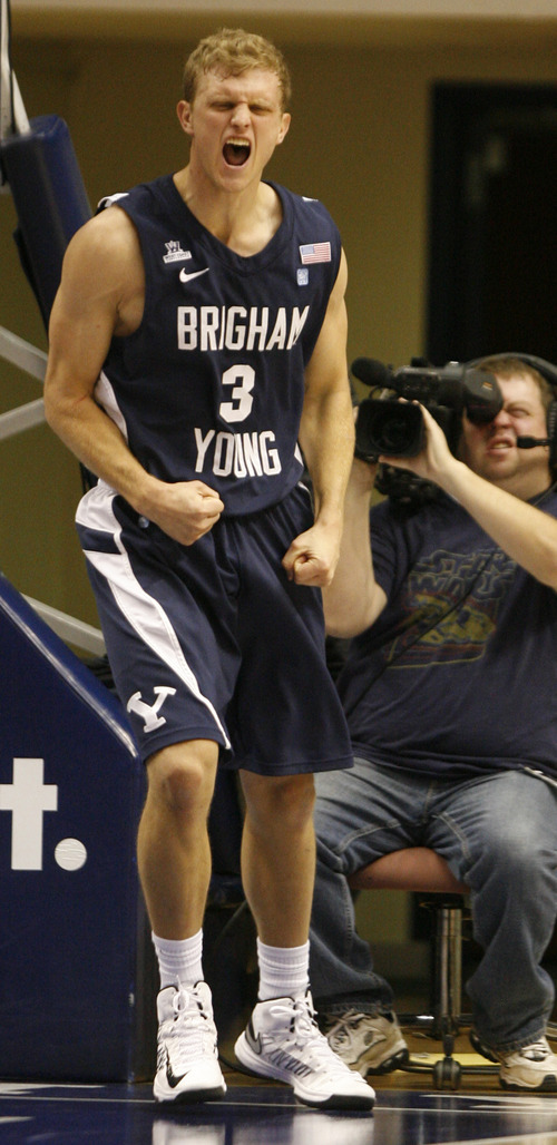 Rick Egan  | The Salt Lake Tribune   Brigham Young Cougars guard Tyler Haws (3) reacts after being fouled, after making a layup, in basketball action between the Brigham Young Cougars and the Utah Utes at the Marriott Center in Provo, Saturday, December 8, 2012.