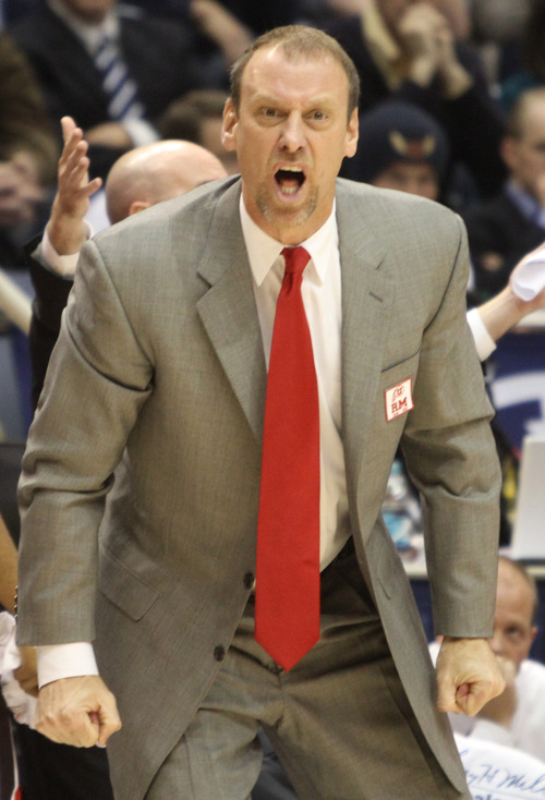 Rick Egan  | The Salt Lake Tribune   Ute head coach Larry Krystkowiak pleads with the referee, after a controversial call, in basketball action between the Brigham Young Cougars and the Utah Utes at the Marriott Center in Provo, Saturday, December 8, 2012.