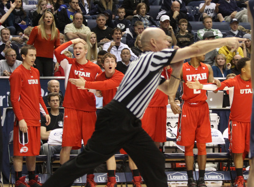 Rick Egan  | The Salt Lake Tribune   The Utes Bench reacts, as the ref gives the ball to the cougars, late in the game,  in basketball action between the Brigham Young Cougars and the Utah Utes at the Marriott Center in Provo, Saturday, December 8, 2012.