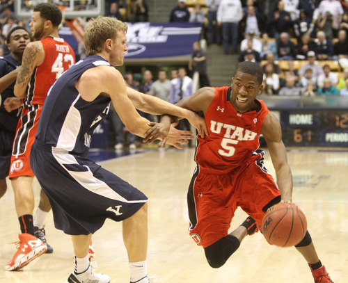 Rick Egan  | The Salt Lake Tribune   Brigham Young Cougars guard Tyler Haws (3) defends as Utah Utes guard Jarred DuBois (5) takes the ball inside with 12 seconds left in the game, in basketball action between the Brigham Young Cougars and the Utah Utes at the Marriott Center in Provo, Saturday, December 8, 2012.