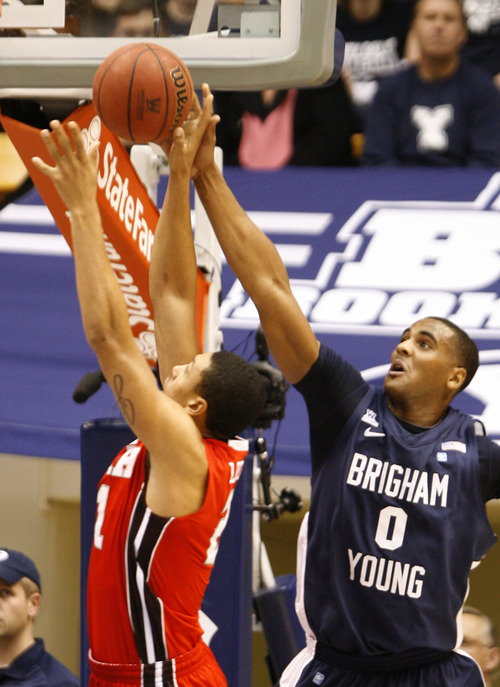 Rick Egan  | The Salt Lake Tribune   Brigham Young Cougars forward Brandon Davies (0) blocks a shot by Utah Utes forward Jordan Loveridge (21)  in basketball action between the Brigham Young Cougars and the Utah Utes at the Marriott Center in Provo, Saturday, December 8, 2012.