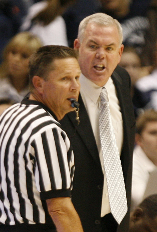 Rick Egan  | The Salt Lake Tribune   Brigham Young Cougars head coach Dave Rose screams at the official, in basketball action between the Brigham Young Cougars and the Utah Utes at the Marriott Center in Provo, Saturday, December 8, 2012.