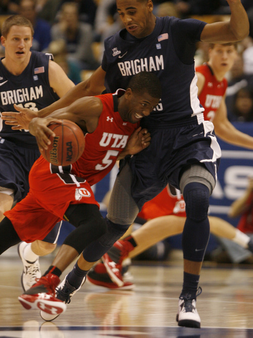 Rick Egan  | The Salt Lake Tribune   Utah Utes guard Jarred DuBois (5) tries to get past Brigham Young Cougars forward Brandon Davies (0) in basketball action between the Brigham Young Cougars and the Utah Utes at the Marriott Center in Provo, Saturday, December 8, 2012.