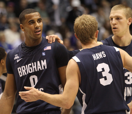 Rick Egan  | The Salt Lake Tribune   Cougar guard Tyler Haws (3) and Nate Austin (33) talk to Brigham Young's Brandon Davies (0) (left) was called for a technical foul, in basketball action between the Brigham Young Cougars and the Utah Utes at the Marriott Center in Provo, Saturday, December 8, 2012.