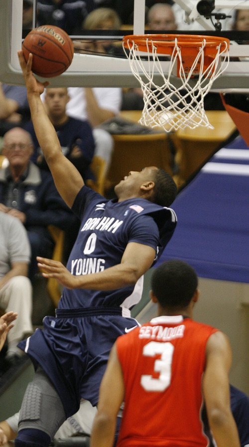 Rick Egan  | The Salt Lake Tribune   Brigham Young Cougars forward Brandon Davies (0) makes a reverse lay-up, in basketball action between the Brigham Young Cougars and the Utah Utes at the Marriott Center in Provo, Saturday, December 8, 2012.