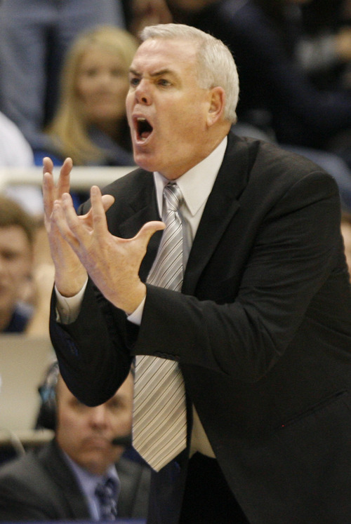 Rick Egan  | The Salt Lake Tribune   Brigham Young Cougars head coach Dave Rose pleads with the official, in basketball action between the Brigham Young Cougars and the Utah Utes at the Marriott Center in Provo, Saturday, December 8, 2012.
