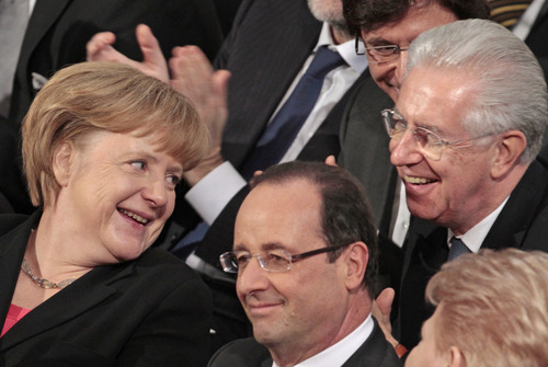 """German Chancellor Angela Merkel, left, talks with Italy's Prime Minister Mario Monti, right, and French President Francois Hollande during the Nobel Peace Prize ceremony at the City Hall in Oslo, Norway, Monday Dec. 10, 2012. The European Union has received this year's Nobel Peace Prize in the Norwegian capital, for promoting """"peace and reconciliation, democracy and human rights"""" in Europe for six decades following the tremendous devastation of World War II. (AP Photo/Yves Logghe)"""