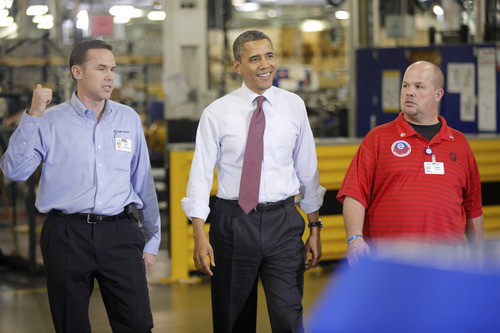 """President Barack Obama walks with Plant Manager and Vice President of Operations Jeff Allen, left, and UAW NW Local 163 Detroit Diesel Engine Unit Shop Chairperson Mark """"Gibby"""" Gibson, right, during a visit to the Daimler Detroit Diesel plant in Redford, Mich., Monday, Dec. 10, 2012. (AP Photo/Charles Dharapak)"""