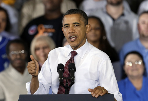 President Barack Obama gestures as he speaks to workers about the economy during a visit to Daimler Detroit Diesel in Redford, Mich., Monday, Dec. 10, 2012.  (AP Photo/Paul Sancya)