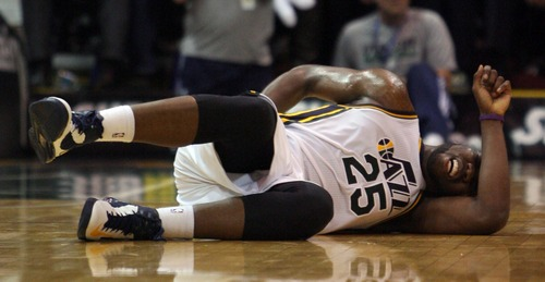 Kim Raff  |  The Salt Lake Tribune Utah Jazz center Al Jefferson (25) lays on the court after being injured during a game against Orlando at EnergySolutions Arena in Salt Lake City on December 5, 2012. Jazz went on to win 87-81.